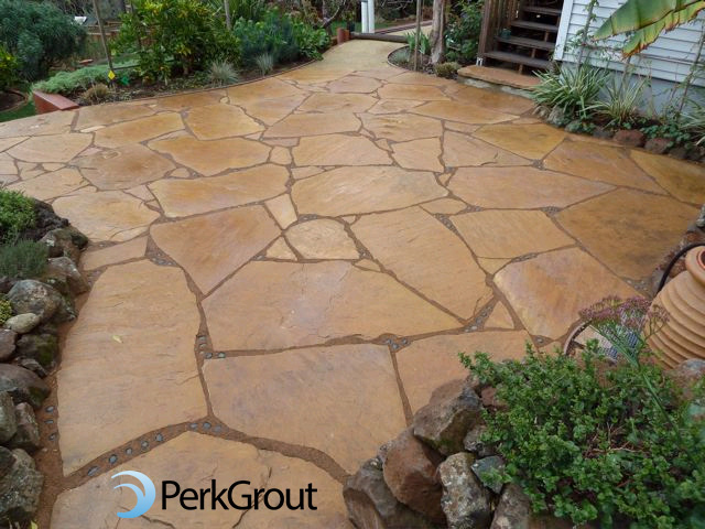 PerkGrout-custom-brown-color-and-decorative-stone-inlay