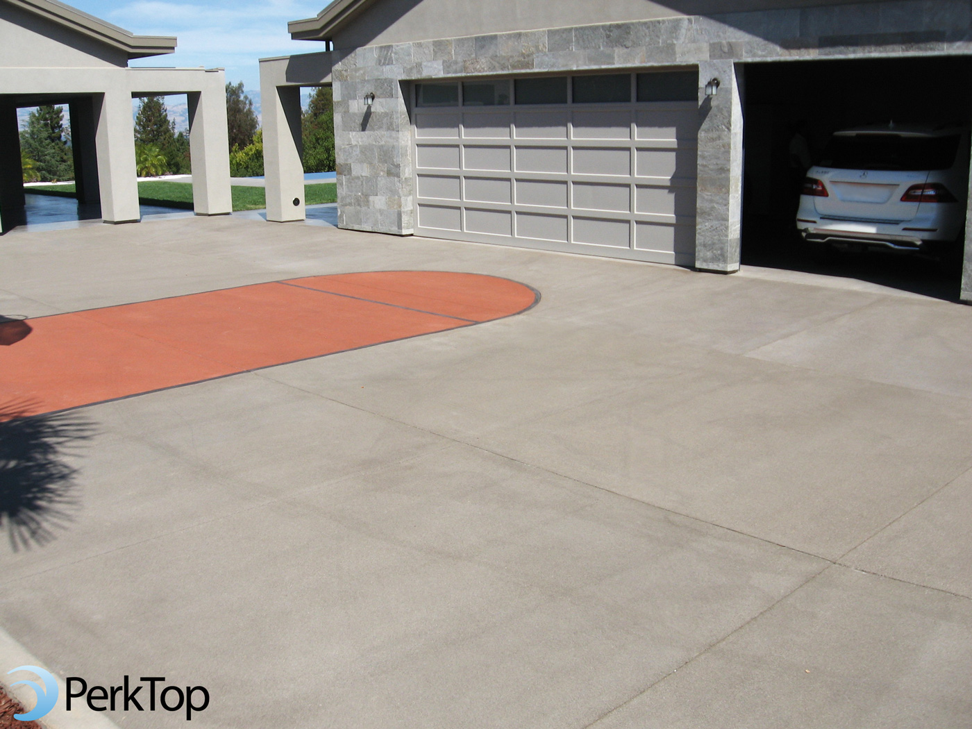 PerkTop-pervious-concrete-basketball-court-on-driveway