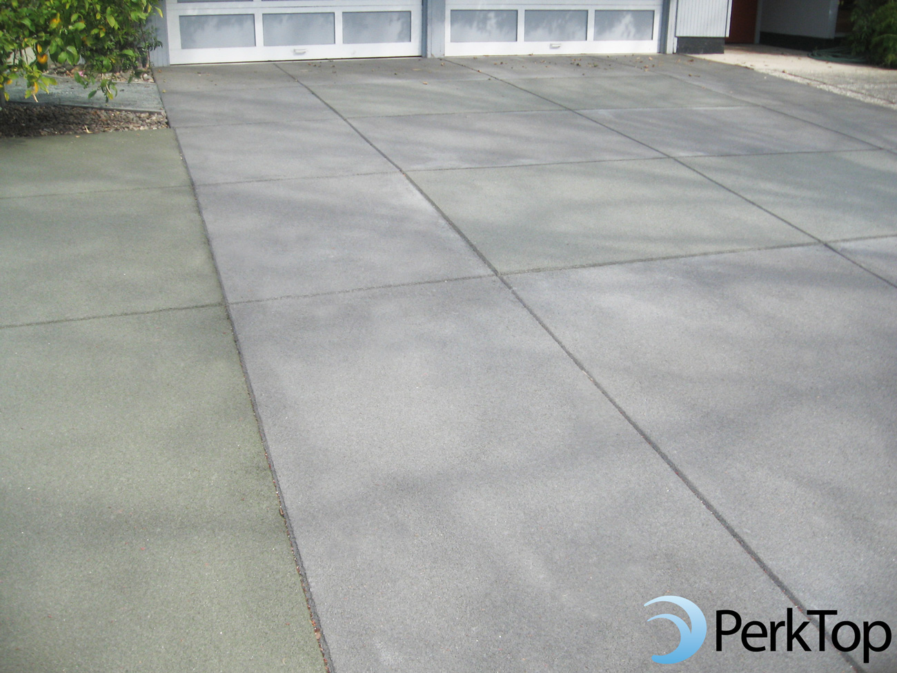 PerkTop-subtle-green-and-grey-pervious-concrete-driveway